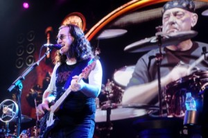 Neil Peart looks on stoically as Geddy Lee sings the words he wrote.