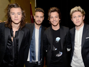 Harry Styles, Liam Payne, Louis Tomlinson, and Niall Horan Courtesy of KEVIN MAZUR/BMA2015/WIREIMAGE and People.com